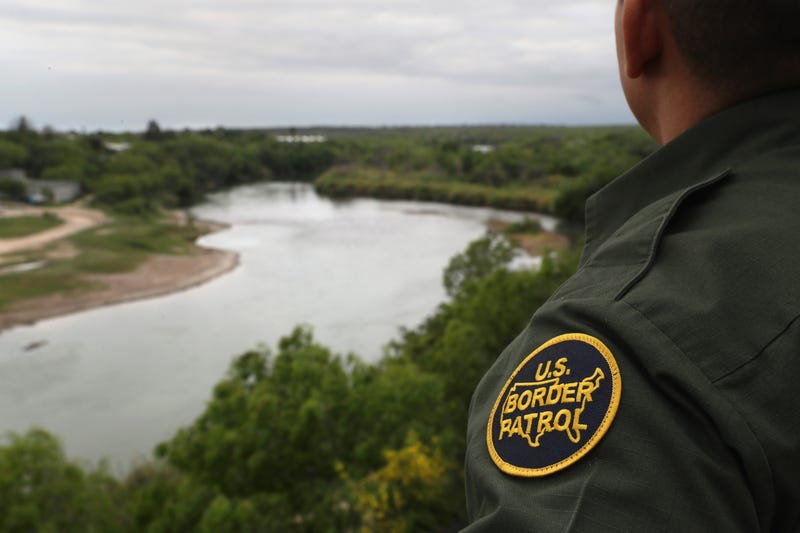 A U.S. Border Patrol agent scans the U.S.-Mexico border while on a bluff overlooking the Rio Grande on March 13, 2017.  (John Moore/Getty Images)