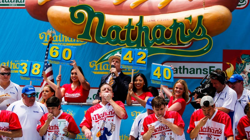 Contestants compete in the annual Nathan's Hot Dog Eating Contest on July 4, 2018 in NYC.