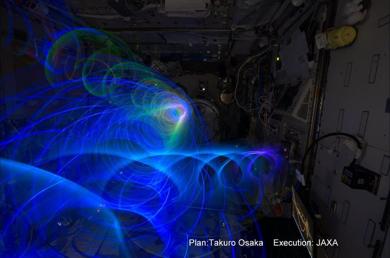 """Illustration for article titled Japanese """"Spiral Top"""" makes zero-gravity light paintings aboard the ISS"""