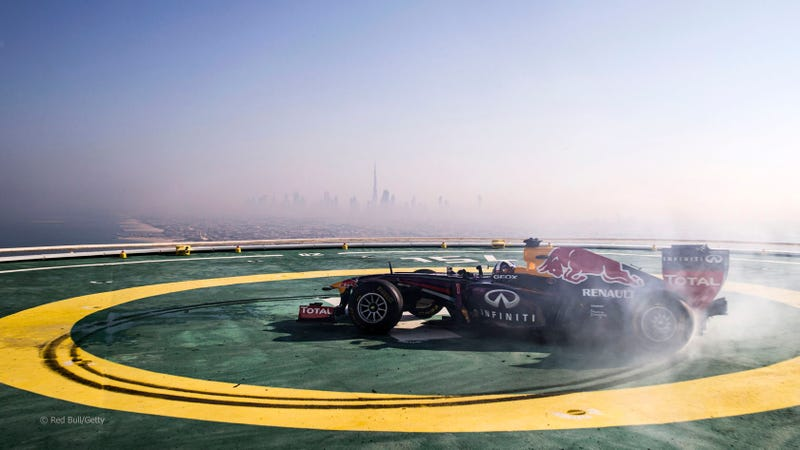 Illustration for article titled Red Bull F1 Did Donuts On Top Of The 689-Foot Burj Al Arab Helipad