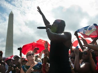 Wyclef Jean performs at a preconference rally. (The Washington Post)