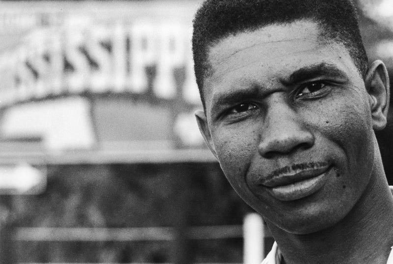 Medgar Evers, NAACP's first field secretary for the state of Mississippi stands nearby a sign of the state Mississippi in this 1958 file photo.