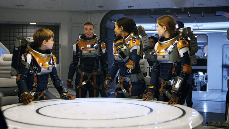The Robinsons don their gear for a mission because they're still lost in space.