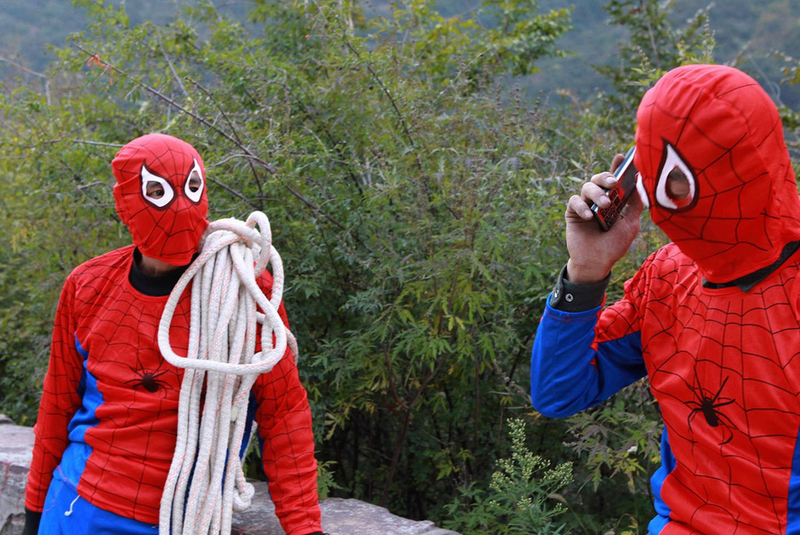 Illustration for article titled Why These Chinese Sanitation Workers Dress Like Spider-Man
