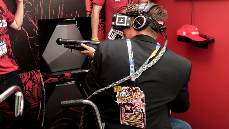 UploadVR founder Will Mason is seen in VR gear at a conference. Photo: AP