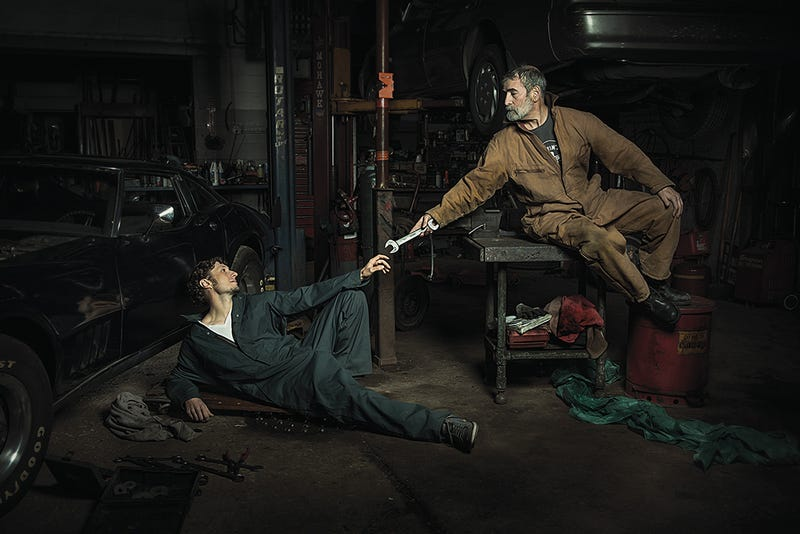 Illustration for article titled Mechanics Reenact Renaissance Paintings; Beautiful And Hilarious