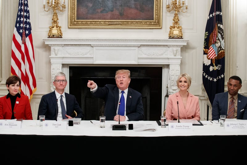 Donald Trump delivers remarks beside Iowa Governor Kim Reynolds, far left, Apple CEO Tim Cook, left,  Ivanka Trump, right, and Johnny C. Taylor, Jr., CEO of the Society for Human Resource Management, far right, during a meeting with the American Workforce Policy Advisory Board inside the State Dining Room of the White House on March 6, 2019 in Washington, DC.