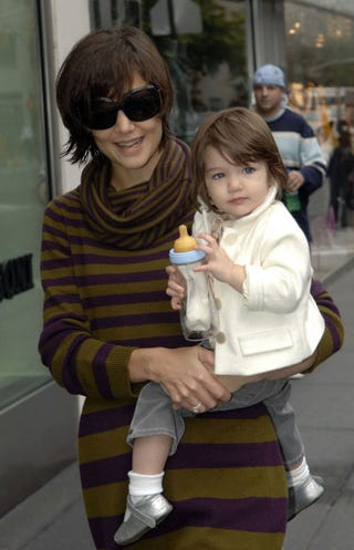 Illustration for article titled Katie & Her Mini-Me: Love Mom's Shades & Suri's Silver Shoes