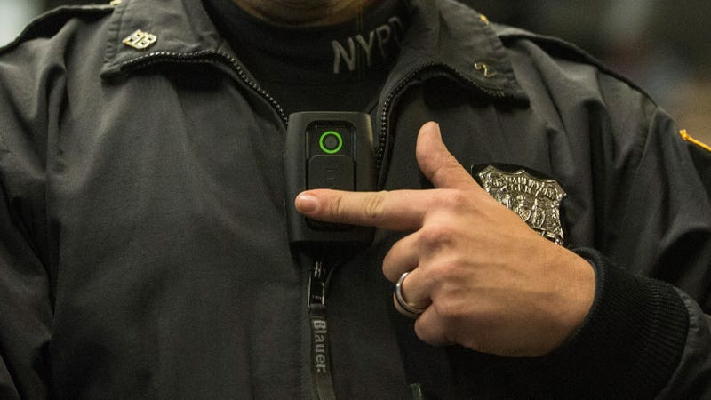 An NYPD officer modeling a body cam in 2014.