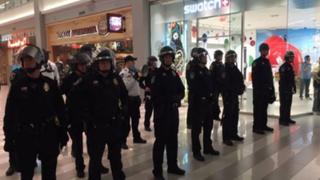 Police gather inside the Mall of America in Minneapolis Dec. 23, 2015, where several Black Lives Matter supporters protested November's fatal police shooting of 24-year-old Jamar Clark. KARE11 Screenshot