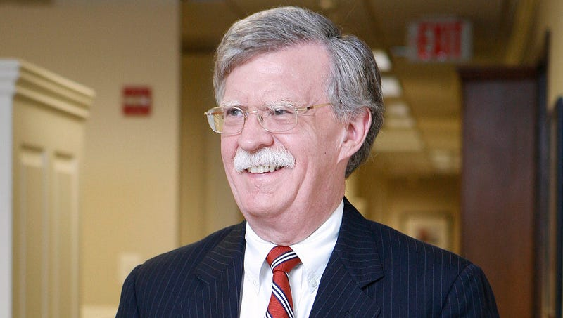 Illustration for article titled John Bolton Arrives In Office Excited To See So Many Familiar Wars