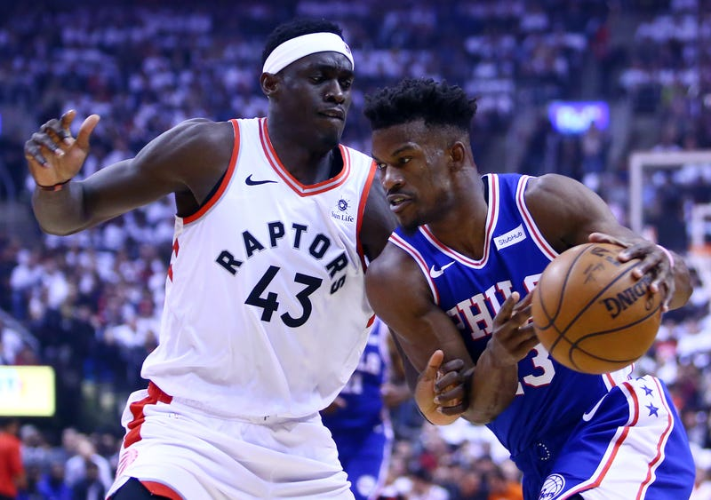 Jimmy Butler of the Philadelphia 76ers, right,  dribbles the ball as Pascal Siakam of the Toronto Raptors defends during Game One of the second round of the 2019 NBA Playoffs at Scotiabank Arena on April 27, 2019 in Toronto, Canada.