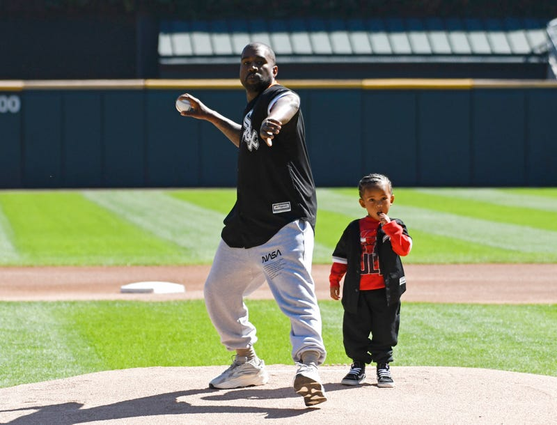 Kanye West and his son Saint throw out a ceremonial first pitch before the game between the Chicago White Sox and the Chicago Cubs on Sept. 23, 2018 in Chicago, Illinois.
