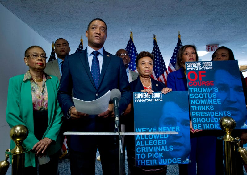 Chairman of the Congressional Black Caucus, Rep. Cedric Richmond, D-New Orleans, accompanied by other members, speaks to the media urging the Senate to reject the Supreme Court nominee Brett Kavanaugh, during his confirmation hearing on Capitol Hill, Thursday, Sept. 6, 2018, in Washington.