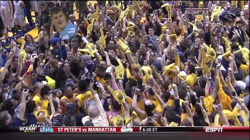 Illustration for article titled WVU Upsets Kansas; Fans Storm Court With Giant Richie Incognito Face