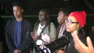 University of Virginia students rally in Charlottesville, Va., to protest the recent beating and arrest of Martese Johnson (far left) by Virginia Department of Alcoholic Beverage Control officers early Wednesday morning. NBC 29 screenshot