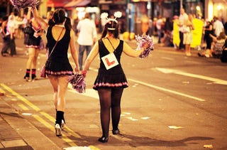 Illustration for article titled Costumed Ladies Go A-Clubbing