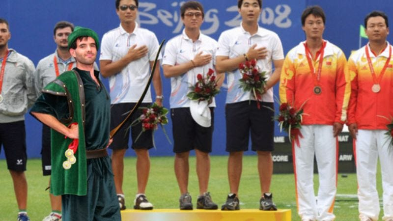 Illustration for article titled Green-Clad Olympic Archer Steals Gold Medals From Rich, Gives Them To Poor