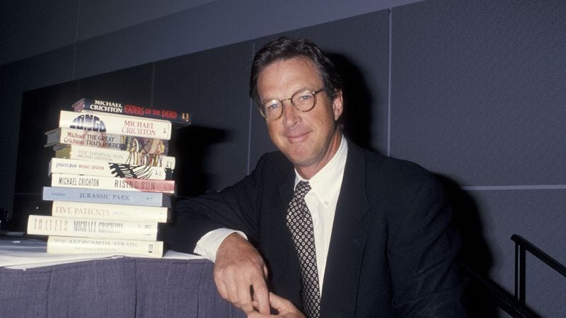 Michael Crichton in 2000, busily inventing an unwritten novel about a camera that kills. (Photo: Getty Images)