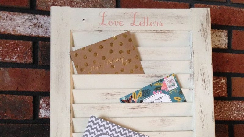 Illustration for article titled Transform an Old Window Shutter into a Mail Organizer