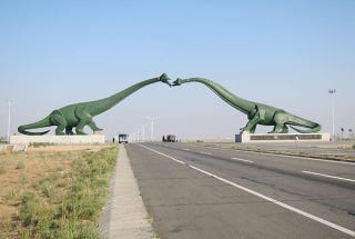 Illustration for article titled These Are The Weirdest Dinosaur Statues Ever