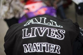 "T-shirts stating ""All Lives Matter"" were on sale for $10 outside City Hall before a protest in honor of Freddie Gray April 25, 2015, in Baltimore.  Mark Makela/Getty Images"