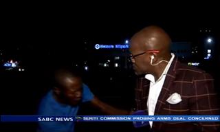 Vuyo Mvoko being mugged on cameraSABC/YouTube screenshot