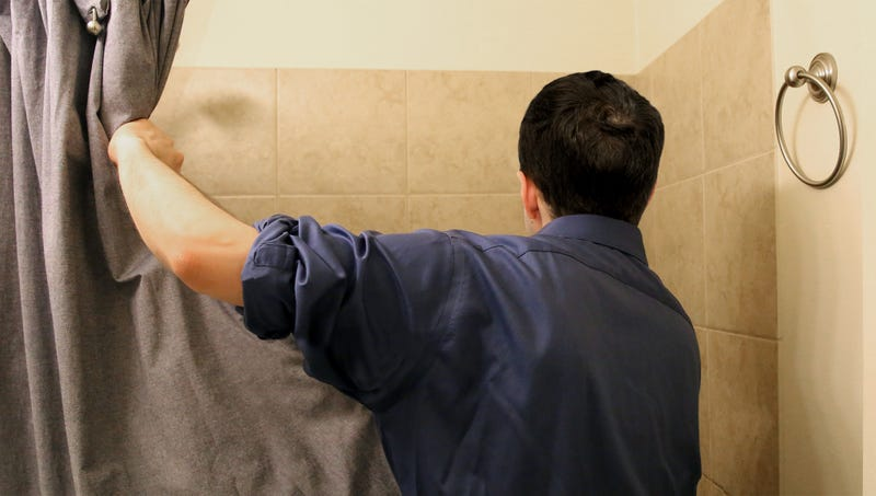 Illustration for article titled 'Aha!' Shouts Devin Nunes Pulling Back Shower Curtain In Hopes Of Revealing Hidden FBI Agent