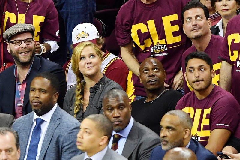 Comedians Amy Schumer and Dave Chappelle attend Game Three of the 2017 NBA Eastern Conference Finals between the Cleveland Cavaliers and the Boston Celtics at Quicken Loans Arena on May 21, 2017, in Cleveland. Jamie Sabau/Getty Images