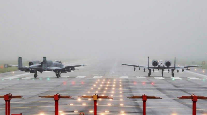 US Air Force A-10 attack aircraft wait to take off on the runway at the Osan US air base in Pyeongtaek, South Korea on August 10, 2017 (Hong Ki-won/Yonhap via AP)