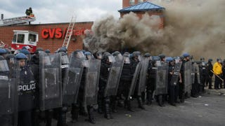 Baltimore police form a perimeter around a CVS pharmacy that was looted and burned during violent protests following the funeral of Freddie Gray April 27, 2015, in Baltimore.Chip Somodevilla/Getty Images