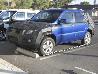 Illustration for article titled 2009 Kia Sportage Gets Face-Lift, Rear Bumper-Lift