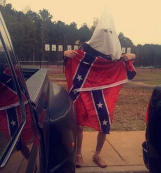 Unnamed student at East Coweta High School in Sharpsburg, Ga., posing in Ku Klux Klan garbTwitter/@SpacemanLozo