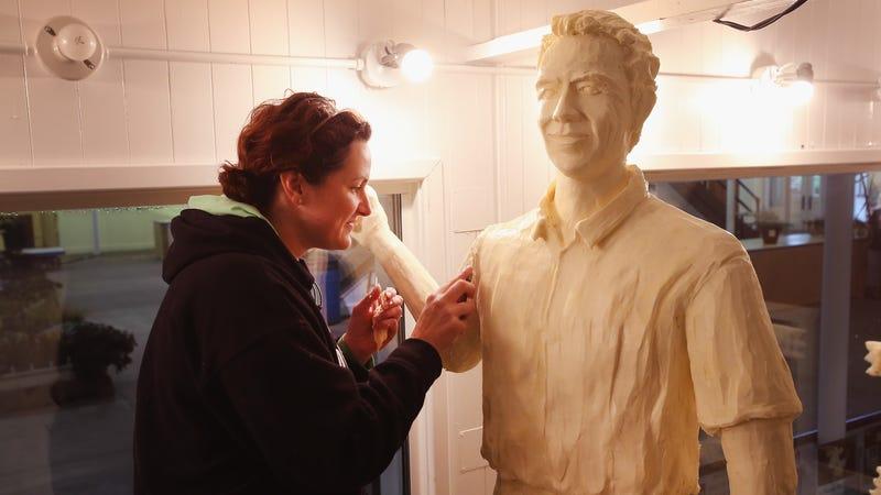 Sarah Pratt carving Butter Kevin Costner
