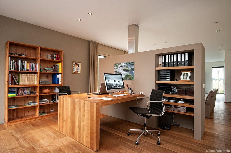Illustration for article titled Earth Tones and Built-Ins: An Open and Integrated Home Office