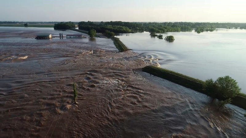 A breached levee on the Arkansas River, a common sight this spring.