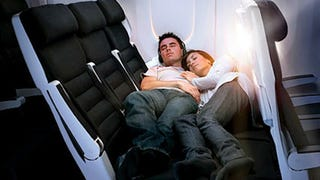Illustration for article titled Airlines Are Beginning To Encourage Cuddling During Long Flights
