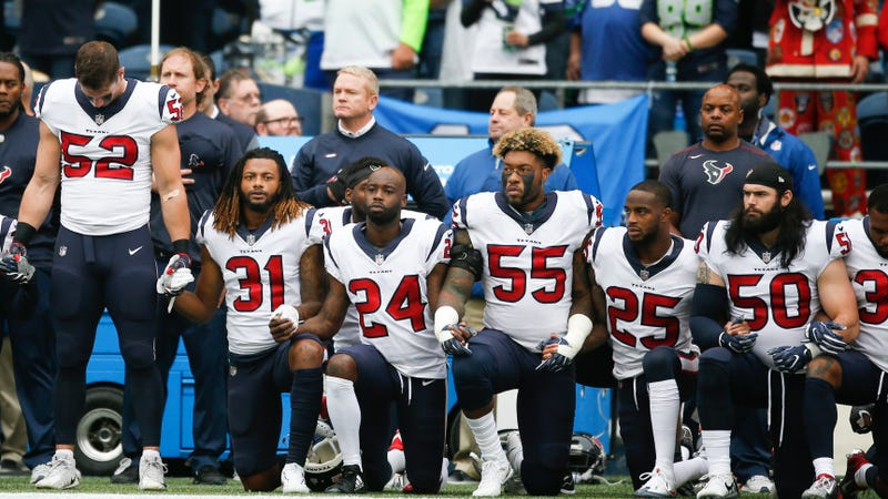 Members of the Houston Texans stand and kneel before the game against the Seattle Seahawks at CenturyLink Field on Oct. 29, 2017, in Seattle.