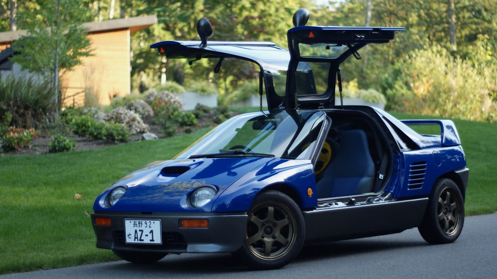 oh my god look there 39 s an autozam az 1 for sale. Black Bedroom Furniture Sets. Home Design Ideas