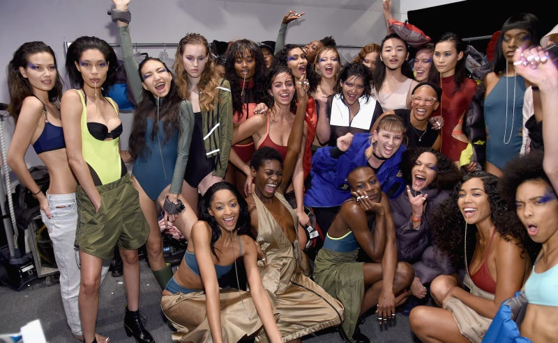 Models backstage at Chromat's Fall 2017 show pose with designer Becca McCharen (center). Image via Getty.