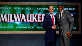 Jabari Parker (right) of Duke poses for a photo with NBA Commissioner Adam Silver after being drafted in the first round by the Milwaukee Bucks during the 2014 NBA draft at the Barclays Center in New York City June 26, 2014.Mike Stobe/Getty Images