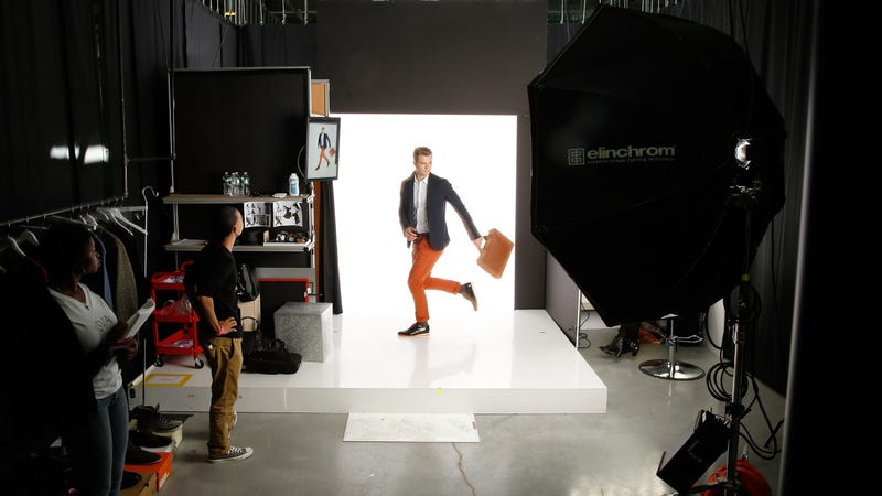 A dapper fellow in orange pants poses backstage at Amazon Fashion Studio Sessions 2014