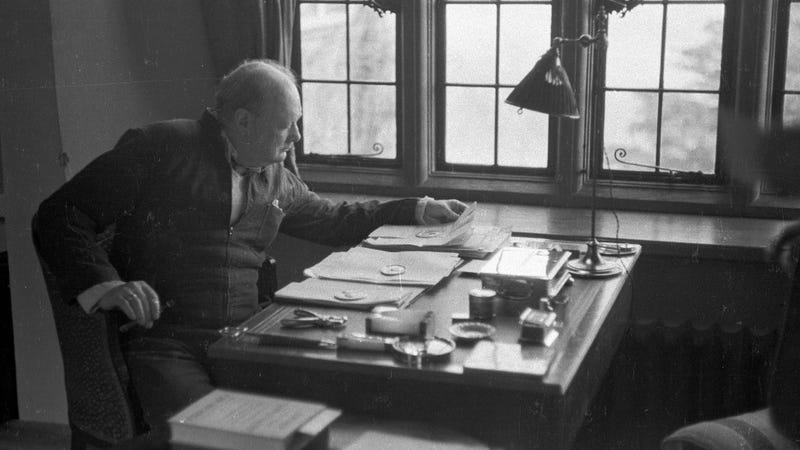 Winston Churchill at his desk in 1939. (Image: Kurt Hutton/Picture Post/Getty)