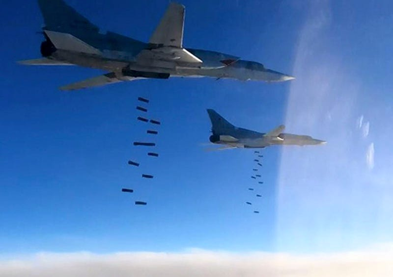 In this photo provided by the Russian Defense Ministry Press Service shows Russian air force Tu-22M3 bombers strike the Islamic State targets in Syria, Monday, Jan. 23, 2017. The air raid targeted the IS around Deir el-Zour in eastern Syria where the IS has launched an offensive against Syrian government forces. (Russian Defense Ministry Press Service via AP)