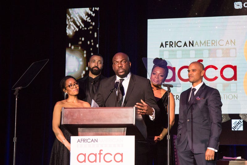 Cast members from OWN's Queen Sugar accept the AAFCA Award for top TV show of 2016 on Feb. 8, 2017. (Sheri Determan for AAFCA)