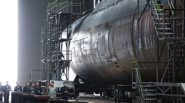 North Korean State Media Posts Photos of Kim Jong Un Touring 'Newly Built' Submarine