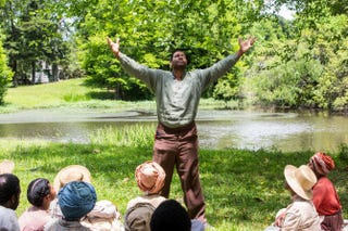 Moses (Mykelti Williamson) praying by a stream in a scene from WGN's UndergroundWGN