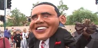 A person dressed up as President Obama at an anti-Obama protest in Arizona (screenshot from KNXV-TV)