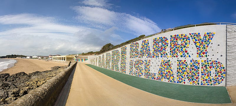 Illustration for article titled This Typographic Climbing Wall Stretches  the Length of a Beach