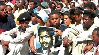 More than 10,000 people attended the unveiling of the statue of Steve Biko, who died in police detention in 1977 in South Africa, in East London Sept. 12, 1997.WALTER DHLADHLA/AFP/GettyImages